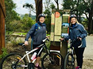 allison and libbie looking at the warburton rail trail map