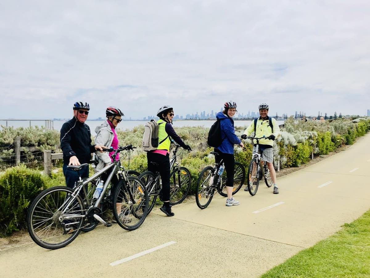 enjoying the melbourne skyline view of a group cycle tour